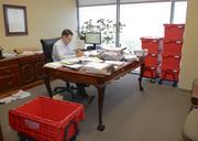 Winstead attorney Adam Darowski gets ready to pack up his office in preparation for a move to the firm's new Uptown digs.