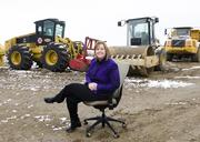 A good idea went south very quickly as a snowy morning foiled a good shot. The idea was to get Keri Samford, The Colony's economic development director, on site at the future Nebraska Furniture Mart for with an office chair overlooking the massive project. What happened was my new office chair was dragged through 1 to 2 inches of mud and set in place at the only accessible spot on the property while Keri Samford slogged through the same mud and played along, even as the shot I had in mind slowly sank into the muck. We salvaged a shot for the front page with the help of Keri's smile. And my power-washing my office chair on Maple Avenue gave great delight to the tire shop guys watching from across the street.