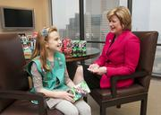North Texas companies including AT&T and Texas Instruments are working with the Girl Scouts to interest girls and young women in the fields of science, technology, engineering and math, collectively known as STEM. Cathy Coughlin, AT&T's senior executive vice president and global marketing officer, meets with Girl Scout Lauren Haydon, an employee's daughter and member of a Girl Scout troop in Frisco.
