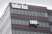 This year the Dallas Business Journal packed up and moved from its previous home on Central Expressway to new digs at Chateau Plaza in Uptown. Here the DBJ's sign that graced NCP III comes down.