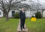 Mayor Mike Rawlings stood for a photo last spring in front of the first of about 250 vacant drug homes that sheltered drug activity in south Dallas that were to be demolished to make way for new development.
