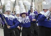Members of the TCU band whoop it up before the game.