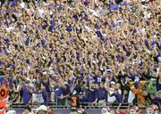The TCU student body cheers on the Horned Frogs Saturday against the University of Oklahoma. TCU will play for a $3.35 postseason payout in the Buffalo Wild Wings Bowl in Tempe, Ariz.
