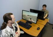 nonPareil alumni-turned-instructors Bruce Drummond, left, and Kyle McNiece troubleshoot 3D animation for a game.