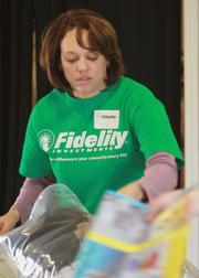 Fidelity employee Sheryl Rodgers sorts clothing at Stepping Stones Foundation that will be given to area families in need.  Rodgers is one of many Fidelity Investments Texas employees who volunteered with Stepping Stones Foundation and Educational First Steps, local nonprofit organizations committed to creating early learning centers of excellence in economically disadvantaged communities. On one single day this December, volunteers performed major service projects in six educational centers across the Dallas/Fort Worth Metroplex. Employees also collected and delivered much-needed books, supplies and toys for these children.