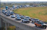 Rush hour traffic in the Dallas-Fort Worth area is filled with people on their way to work.