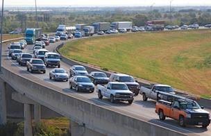 Commuters in the Dallas-Fort Worth area must put up with heavy traffic such as these drivers merging onto State Highway 121 from westbound Interstate 635