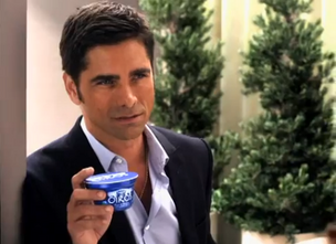 A screenshot of the TV ad with John Stamos for Oikos yogurt.