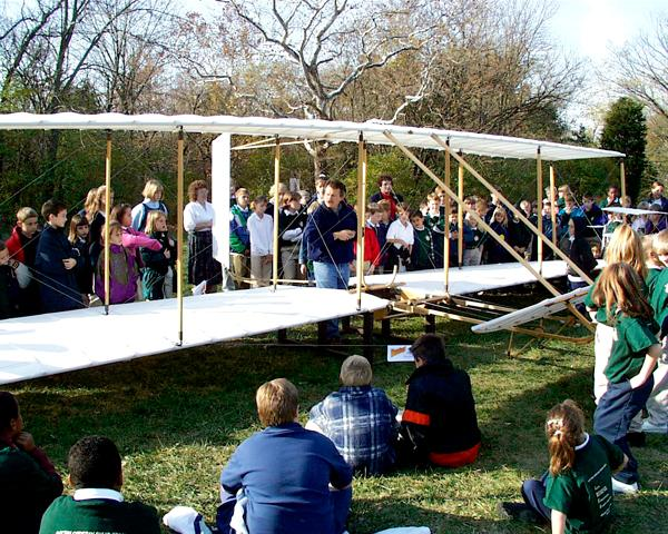 Nick Engler demonstrates the 1902 Wright glider to a bunch of kids at Sugard Creek School north of Dayton.