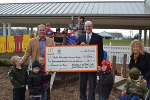 United Rehabilitation Services of Greater Dayton: Doug Blanford, McDonald's Operations Manager, presents Community Grant funds to Dennis Grant, Executive Director, and Jonell Esparza, Youth Services Manager, of United Rehabilitation Services of Greater Da
