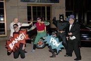Batman and Robin battle the Penguin at the Superhero Costume Ball.