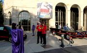 Patrons outside the Dayton Art Institute pose with the Batmobile.