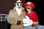 Dave Schweitzer and Alexis Larsen don their favorite superhero costumes.
