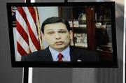 U.S. Rep. Steve Austria, R-Beavercreek, takes part in the panel discussion via ooVoo Internet video chat from his office in Washington, D.C., where Congress was in session.