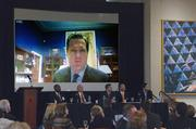 U.S. Rep. Michael Turner, R-Centerville, takes part in the panel discussion via ooVoo Internet video chat from his office in Washington, D.C., where Congress was in session.