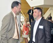 Doug Meyer, with Brixey & Meyer, talks with Jason Mahoney
