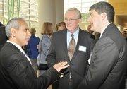 (Left) Herman Chandiramani, CFO of Coolidge Wall Co., talks with Clay Mathile.