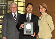 Carol Clark and Berkwood Farmer present Vishal Soin with an award for his induction into the 40 Under 40 Hall of Fame.