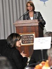 Publisher Carol Clark emcees the event