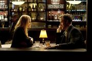 Stephen (Ryan Gosling) and Molly (Evan Rachel Wood) have a drink and talk in the motel bar in Columbia Pictures' IDES OF MARCH.