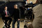Ryan Gosling, left, with Director George Clooney on the set of Columbia Pictures' THE IDES OF MARCH.