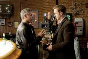 Director George Clooney, left, and Ryan Gosling on the set of Columbia Pictures' THE IDES OF MARCH.