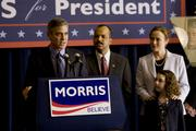 Governor Morris (George Clooney, left) addresses supporters after receiving Senator Thompson's (Jeffrey Wright, center) endorsement; Morris' wife, Cindy (Jennifer Ehle, right) and their daughter (Talia Akiva, bottom right) stand by in Columbia Pictures' IDES OF MARCH.