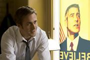 Ryan Gosling (left) with George Clooney (right, poster) stars in Columbia Pictures' IDES OF MARCH.