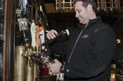 Steve Tieber, the Dublin Pub co-owner, pours a draft beer at his pub while discussing the growth of his business.