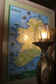 A map of Ireland hangs on the wall of the Dublin Pub by a traditional street lamp.