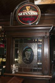 The inside of the pub includes stained-glass and etched-glass artwork.