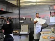 The Flying Pizza223 N. Main St.    Owner Frank Graci tosses some dough to prepare a pizza.