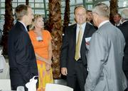 Tim Schmalz (center right) and Kim Ashley (center left) of Anthem talk with guests at the 2011 Healthiest Employers in Dayton awards.