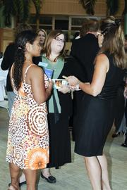 Amy Cunningham (center) of YMCA of Greater Dayton talks with other guests at the awards banquet Thursday morning.