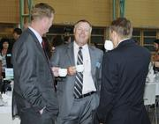 John Barron (center) of Brower Insurance talks with other guests Thursday.