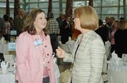 Jenny Michaels (left) of CareSource talks with DBJ Publisher Carol Clark at the Healthiest Employers in Dayton event.
