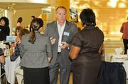 Michael Emoff of Shumsky talks to other attendees at the event.