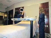 Amanda Veldman (right) and Jeanne Ponziani, both nurses at Miami Valley Hospital South, show off one of a new patient room at the Centerville hospital's new five-story patient tower.