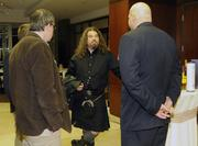 "Jeff Topping (center), AKA ""The Wild Scotsman,"" talks with attendees of the event prior to conducting the tasting."