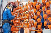 Mixer parts are inspected as they move along a conveyor after being painted at the KitchenAid factory in Greenville.