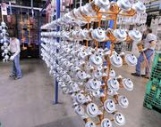 Racks of part hang before being sent through to be painted at the KitchenAid factory in Greenville.