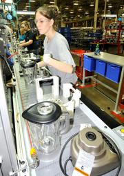 Michelle Jennings works on the blender assembly line at the KitchenAid factory in Greenville.