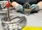 Mixer wire whisks being made with pieces of stainless steel at the KitchenAid factory in Greenville.