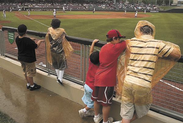 Fans watch a Dayton Dragons minor league baseball game. The team is just weeks away from breaking the all-time professional sports sellout record previously set by the Portland Trailblazers NBA team.
