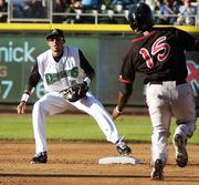 Dayton Dragons shortstop Billy Hamilton (4) takes a throw to tag out Markus Brisker (15) of the Lansing Lugnuts who was attempting to steal second base during a game at Fifth Third Field Tuesday, June 28, 2011.