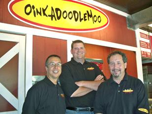 Franchising: (Left to Right) Tom Donaldson, a franchisee for OinkADoodleMoo; Mark Peebles, founder and president; and Ralph Gamberdella, co-founder, stand outside the OinkADoodleMoo restaurant in Englewood.