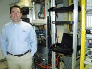 Precautions: David Mezera, president of Donet Inc., stands in the company's server room at its downtown Dayton headquarters.