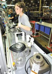 Team Effort: Michelle Jennings works on the blender assembly line at the Kitchen Aid factory in Greenville.