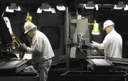 Workers inspect brake parts at the Anna Honda Plant, located north of Dayton