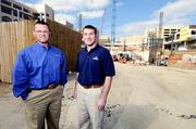 Healthy Growth: Andrew Goetz (left) and Chris Freitag, of Shook Construction, stand outside the site of the Miami Valley Hospital heart tower when that was under construction. The company has worked with Skanska on projects in the Dayton region.